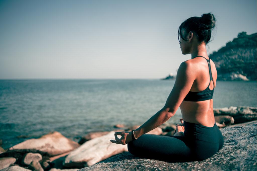 Woman yoga on the beach vintage color.