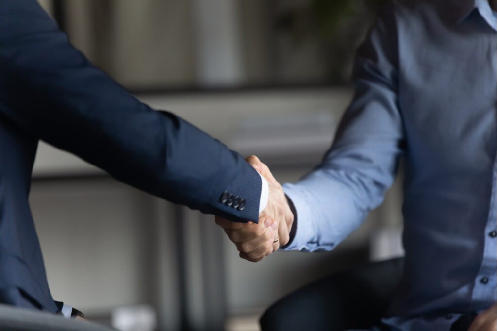 Two businessman shaking hands for closing a deal without free money.