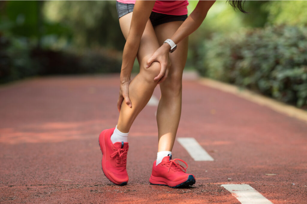 What are shin splints which this female runner suffering from after running.