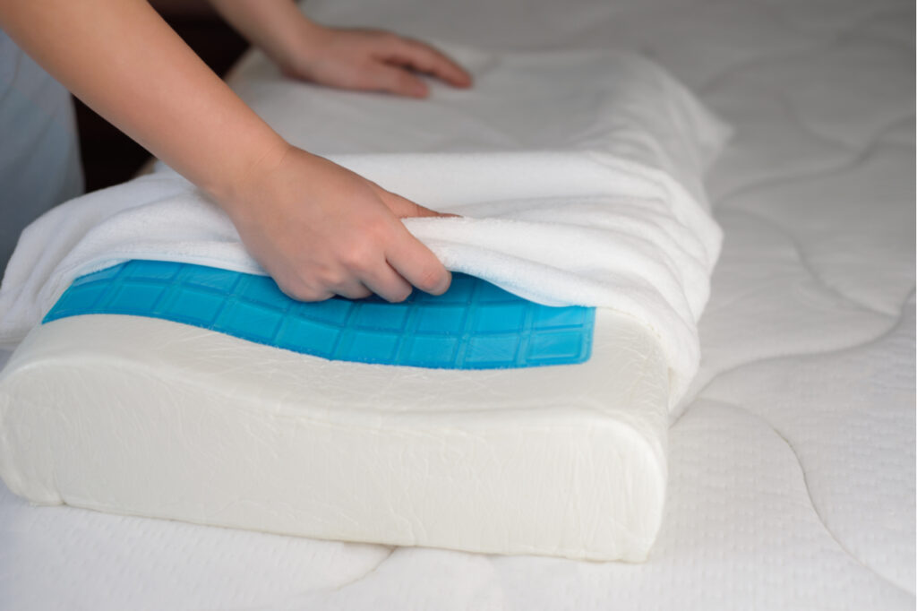 Women's hands put a cover on the orthopedic pillow with cooling gel. Protecting the foam pillow from moisture.