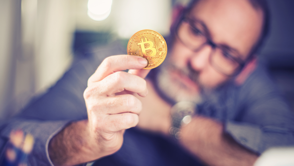 bitcoins - Bitcoin in hand of a casual businessman wondering what the future is