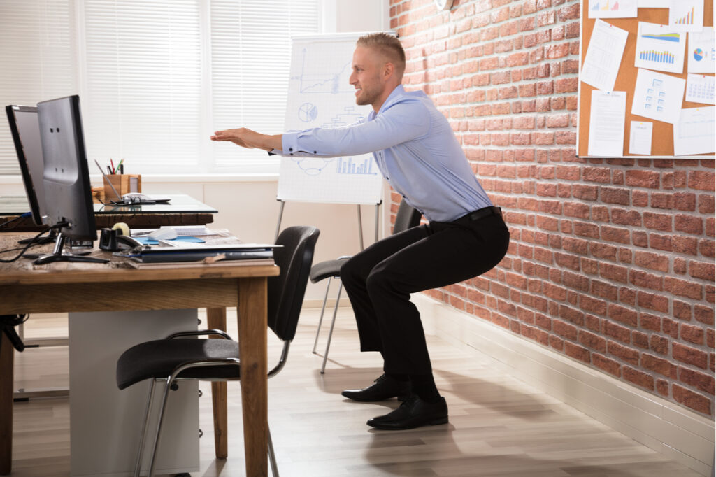 Businessman doing an exercise in the office.