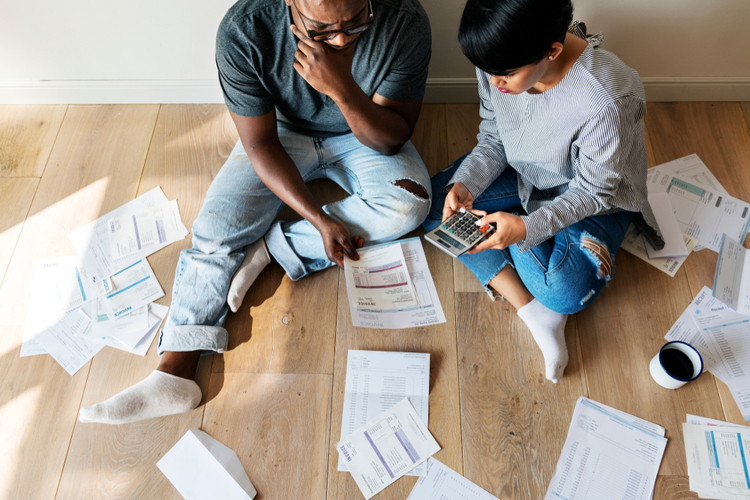 Couple managing the bills trying to get out of debt.