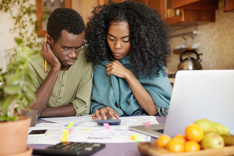 A couple evaluating their current financial situation.