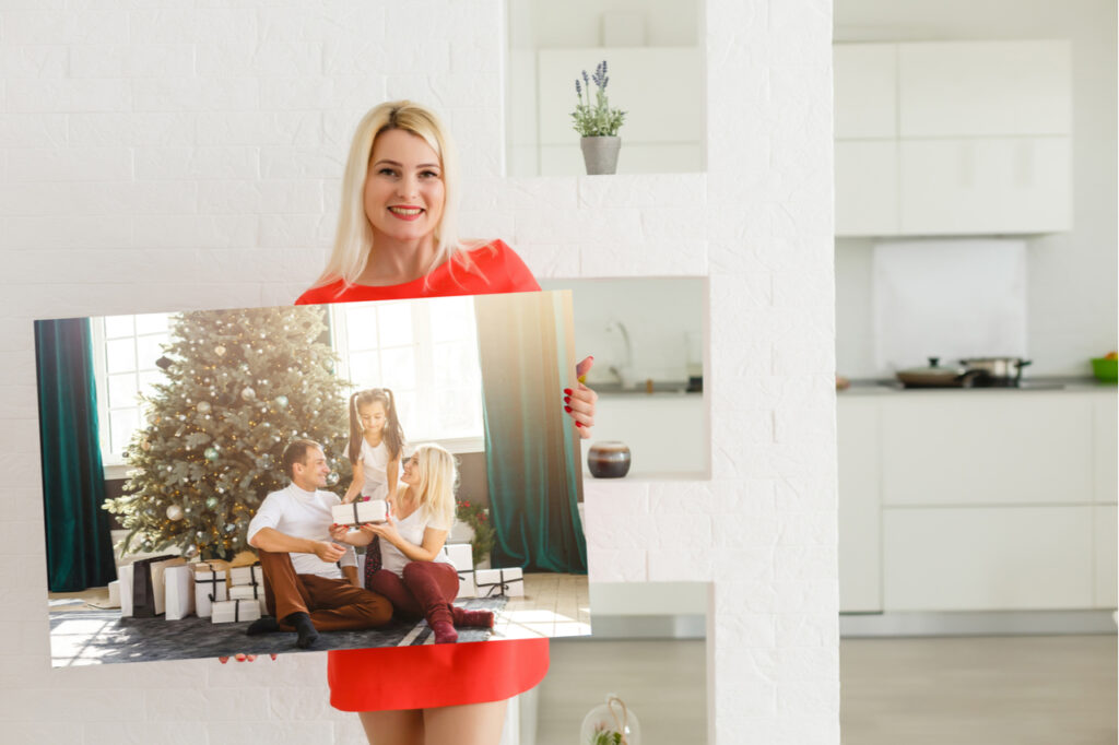 Woman holding a gift photo canvas which is one way on how to show love during Mother's Day.