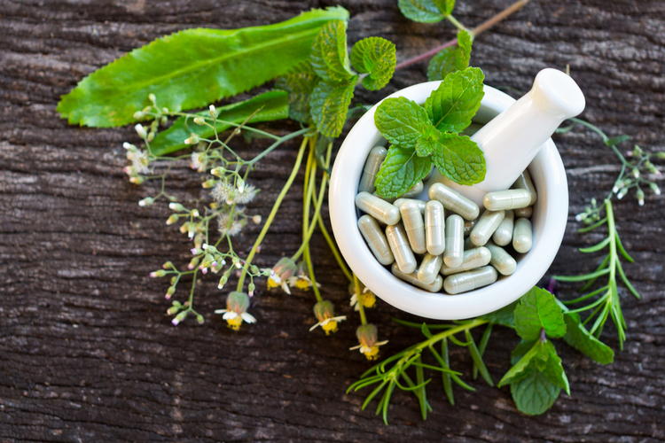 plants and herbs with capsules in