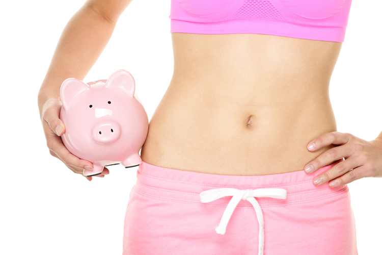 Fit woman with piggy bank..