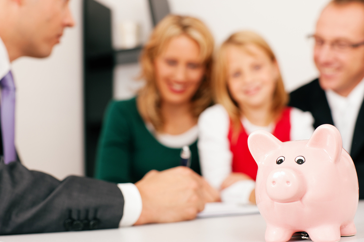 Family with their consultant doing some financial planning.