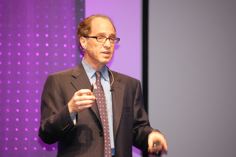 A photo of Ray Kurzweil as a speaker.