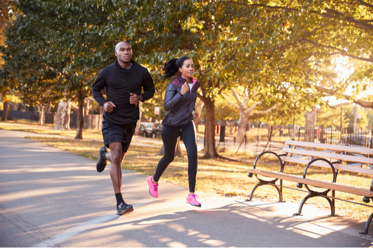 Couple jogging in a park.
