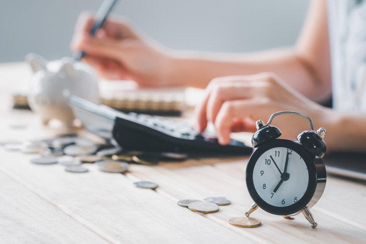 Woman checking lower interest rates to save time and money.