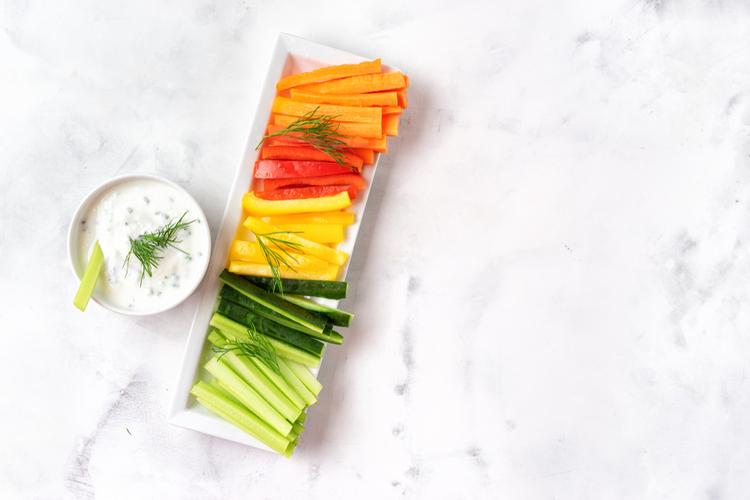 Colorful vegetable sticks with greek yogurt dip.