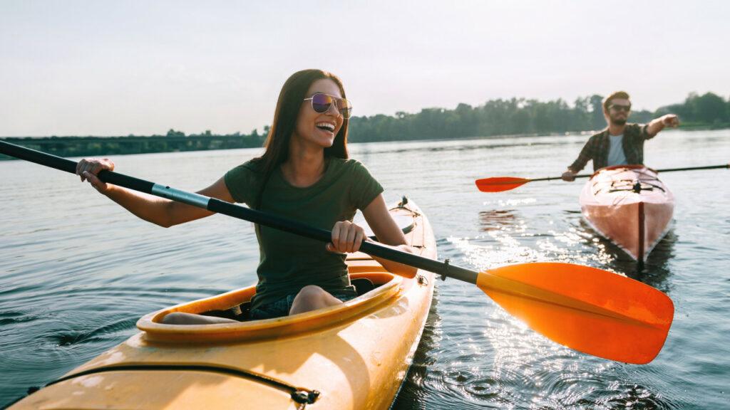 Woman and Man Kayaking