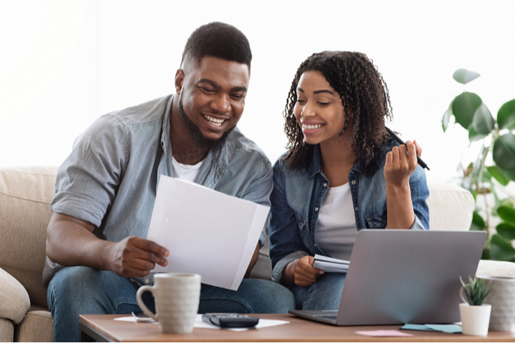 Happy couple doing financial planning.
