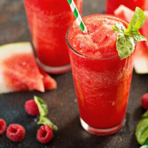Refreshing cold summer drink watermelon slushie with basil.