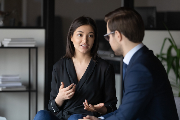 Woman sharing opinion to co-workers.
