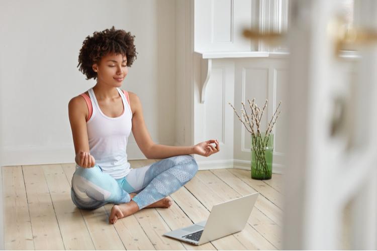Woman meditating doing yoga.