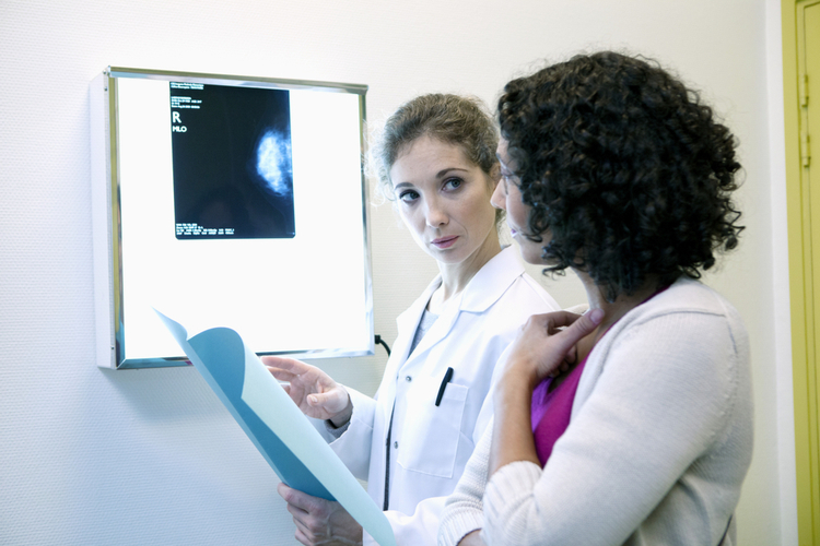 Woman consulting a doctor about her mammogram result.