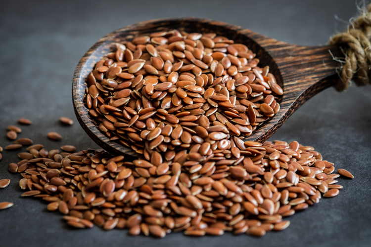 Flax seeds and a wooden spoon.