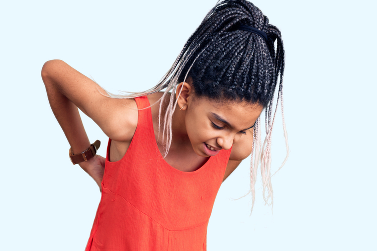 Girl wearing casual clothes suffering of backache.
