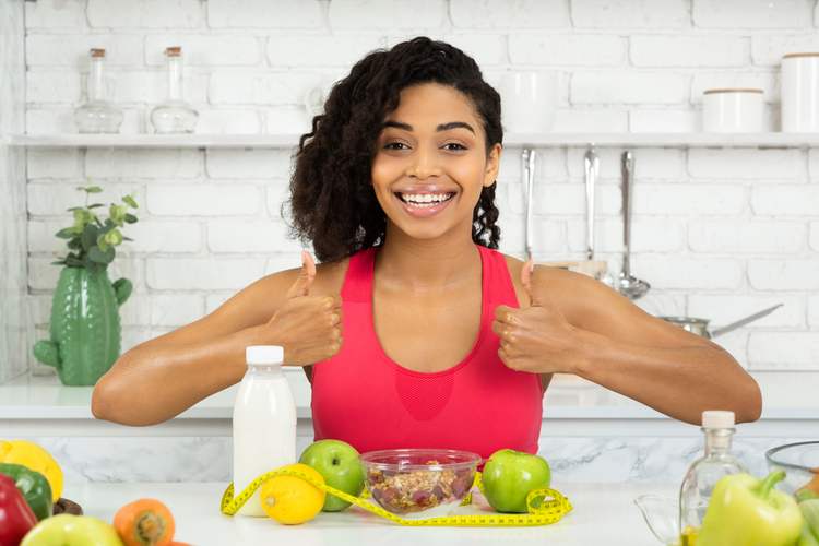 Woman feeling excited to eat with thumbs up.