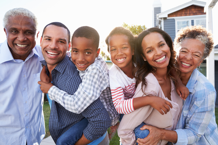 Portrait of a generation of happy family outdoors ready for trust & will estate planning.